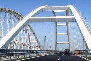 Компания Ротенберга получит деньги на патриотичную подсветку Крымского моста