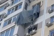 Необычное знакомство: парашютист приземлился на окно краснодарской высотки
