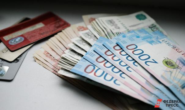 Новый законопроект может оставить россиян без возможности расплачиваться картой за рубежом