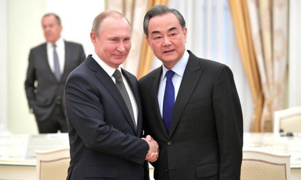 Путин и Ван И
